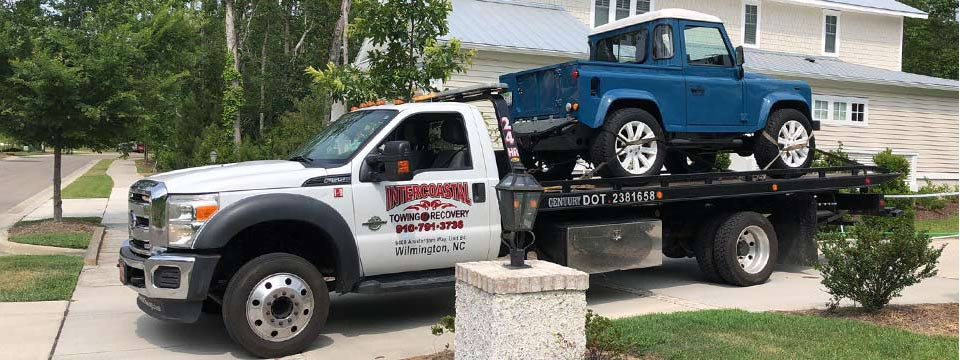 High end vehicle towing service with the Intercoastal rollback tow truck Geocode: @34.2608454,-77.8488667